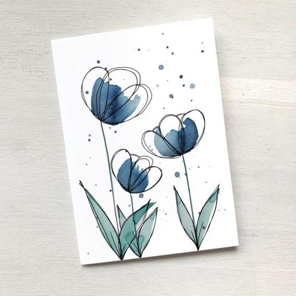 Grusskarte mit blauen Blumen