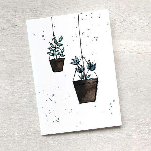 Karte mit zwei Hängepflanzen im Topf